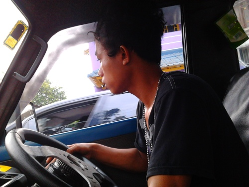 The 15th years old boy work as a public transportation driver at Jakarta